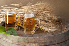 Still life with beer. And barrel stock images