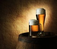 Still Life of beer and barrel on a old stone. Still Life of beer and barrel on a grange background royalty free stock image
