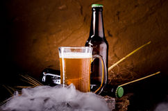 Still Life with of beer and draft beer with ice  by the glass.  Royalty Free Stock Images