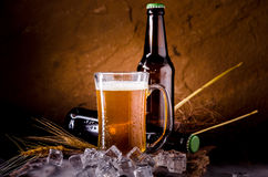Still Life with of beer and draft beer with ice  by the glass.  Stock Image