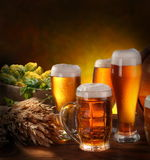 Still Life with beer glasses. Still Life with a keg of beer and draft beer by the glass stock photography