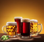 Still-life with beer glasses. On a yellow background Royalty Free Stock Photos