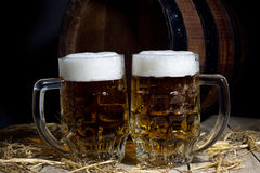 Still Life with Beer Mugs and Barrel on Black Background Stock Photos