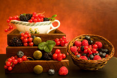 Still Life With Berries. Still life with soft fruits in wooden drawers and basket Royalty Free Stock Photography