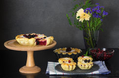 Still life with berry pies and cup of tea Stock Images