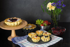 Still life with berry pies and cup of tea Royalty Free Stock Photo