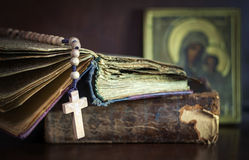 Still Life with Bible. Still on the subject of the church with the Bible, cross, rosary, icon Stock Photos
