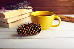 Still life with big yellow cup Royalty Free Stock Photos