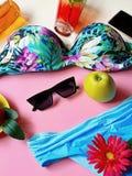 Bikini Summer Girl women clothes beach beachwear sunglasses bag juice iphone  wildflowers travel holiday strawbery  on yellow pla. Still Life Bikini Summer Girl stock photography