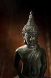 Still life black Buddha statue. Stock Image