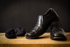 Still life with black man's shoes and socks Royalty Free Stock Photos