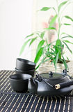 Still life with black oriental teapot set Royalty Free Stock Image