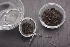 Still life with black tea leaves Stock Photo