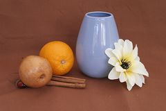 Still life with a blue vase, fruit and flower stock photo