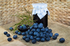 Still life with blueberries, confection, jam and twigs Royalty Free Stock Photos