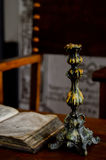 Still life with book and candlestick. Stock Photography