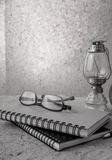 Still life with book Kerosene lamp and glasses Royalty Free Stock Images