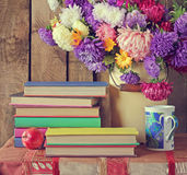 Still life with books and a bouquet of asters. Back to school Royalty Free Stock Photos