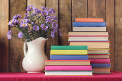 Still life with books and a bouquet. Still life with books and an autumn bouquet against from boards Stock Image