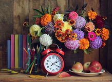 Still life with books and bouquet. Back to school. Stock Photos