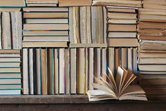 A still life with books and hours. The books which are tied up by a blue tape and hours on the table covered with a red cloth. A still life with books and hours Royalty Free Stock Image