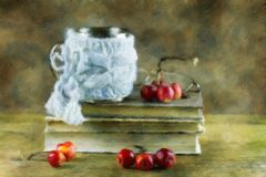Still-life with books and paradise apples. Stock Image