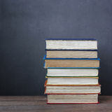 Still life with books. On a wooden table against a dark background Royalty Free Stock Photos