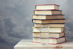 Still life with books. On a wooden table against a dark background Stock Photography