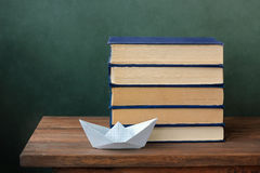 Still life with books. On a wooden table against a dark background Royalty Free Stock Image