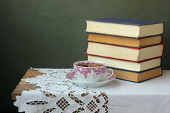 Still life with books. On a wooden table against a dark background Stock Image