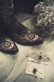 Still life of boots and flowers. On lace royalty free stock photography