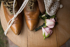 Still life of boots and flowers Royalty Free Stock Images