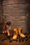 Still life with boots and retro camera on wooden Stock Photography