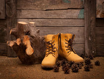 Still life with boots on wooden grunge background Stock Photo