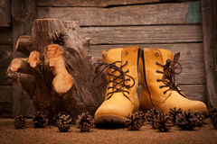 Still life with boots on wooden grunge background Royalty Free Stock Images