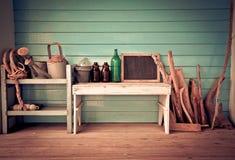 Still life bottle, board, branch,Watering Stock Photos