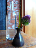 Still-life of a bottle and a flower Royalty Free Stock Photo