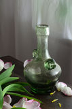 Still life with bottle and flowers Royalty Free Stock Photo