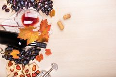 Still life with a bottle and a glass of red wine, grapes and chocolate with strawberries Royalty Free Stock Image