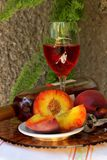 Still life with bottle,  glass of wine and peaches Royalty Free Stock Photos
