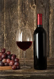 Still-life. Bottle of red wine, glass and grapes. Still-life. Bottle of red wine, wineglass and grapes stock photo