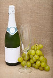 Still-life from bottle of sparkling wine, grapes Royalty Free Stock Images