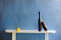 Still-life with bottle and vegetables Royalty Free Stock Photography