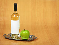 Still-life - bottle of white wine and green apple Stock Photo