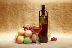 Still-life - bottle of wine and fruit Royalty Free Stock Image