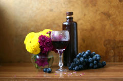 Still life with bottle and wineglass. Vintage still life with bottle and wineglass Royalty Free Stock Photo