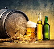 Still Life with bottles of beer and mug. Toned in yellow and blue Royalty Free Stock Photography