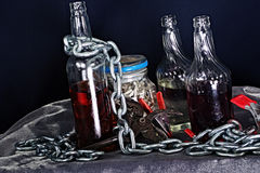 Still life with bottles, chain & tools 2 Royalty Free Stock Images