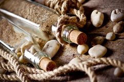 Still life with bottles and stones Royalty Free Stock Photography