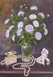 Still life of bouquet asters in a glass jug with beads and figurine of a dog on a table. Original oil painting on canvas royalty free illustration